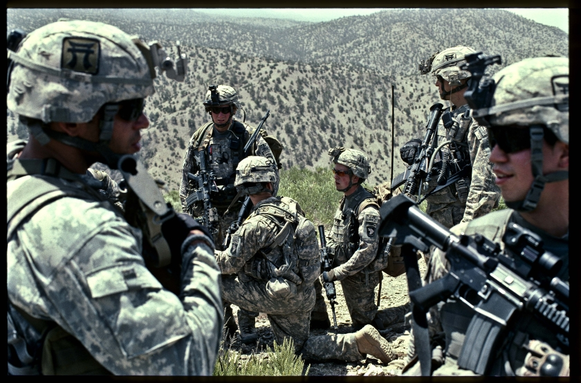 "3rd Brigade, 101st Airborne ""Rakkasans"" on a hilltop in Afghanistan. Photo by Bill Putnam."