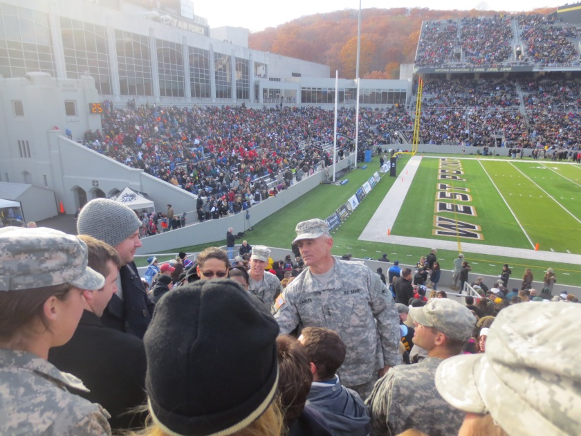 Lieutenant General Robert Caslen, the Superintendent of West Point, shaking the hand of a veteran in the stands at the Army-Western Kentucky game, Saturday 9 November 2013.