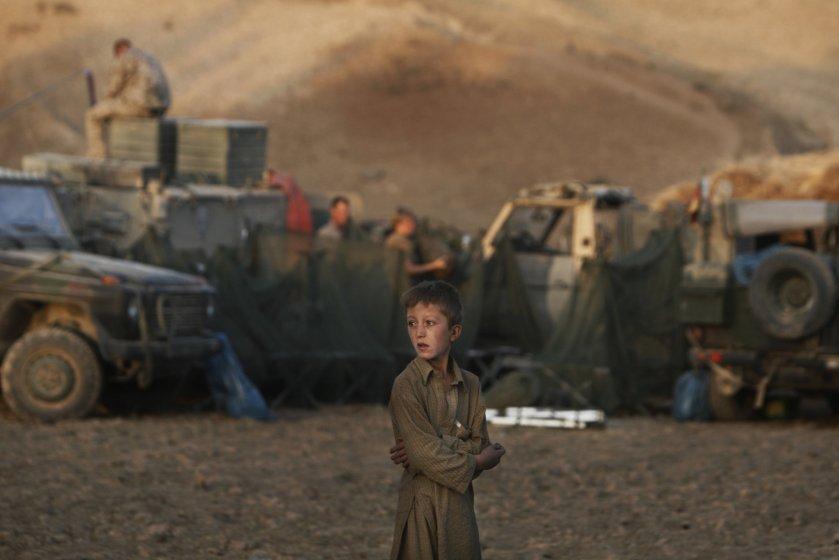 Anja Niedringhaus, An Afghan Boy with German troops, near Kunduz, September 2009