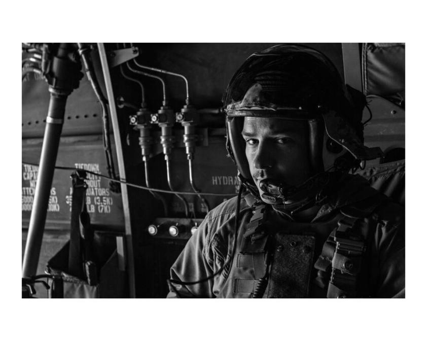Is war lit all about the angst of young white males?  Photo of a helicopter crewman by Bill Putnam.