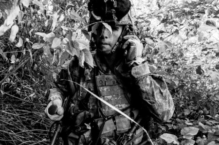 Soldier with mine detector, Iraq, 2005, by Bill Putnam.